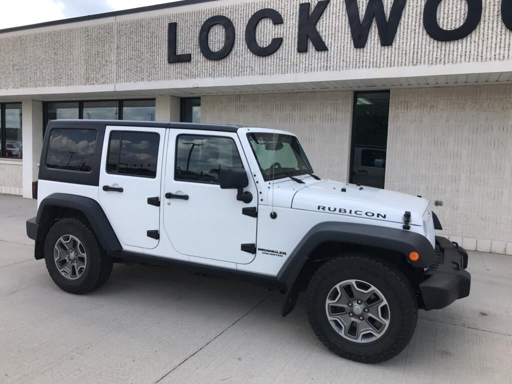 Used 2013 Jeep Wrangler Unlimited Rubicon with VIN 1C4BJWFG8DL551200 for sale in Marshall, Minnesota